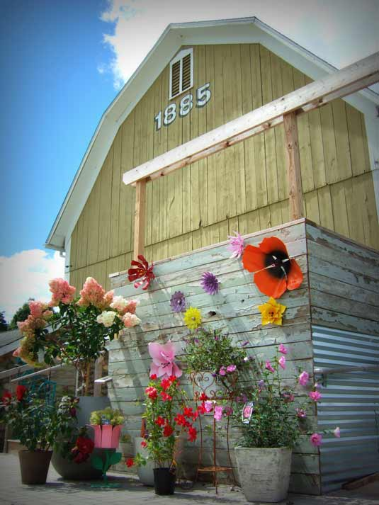 Lotus Gardenscapes | Bloom! Gardens & Nursery -- Barn with a Flower Wall | Baker Rd. Dexter