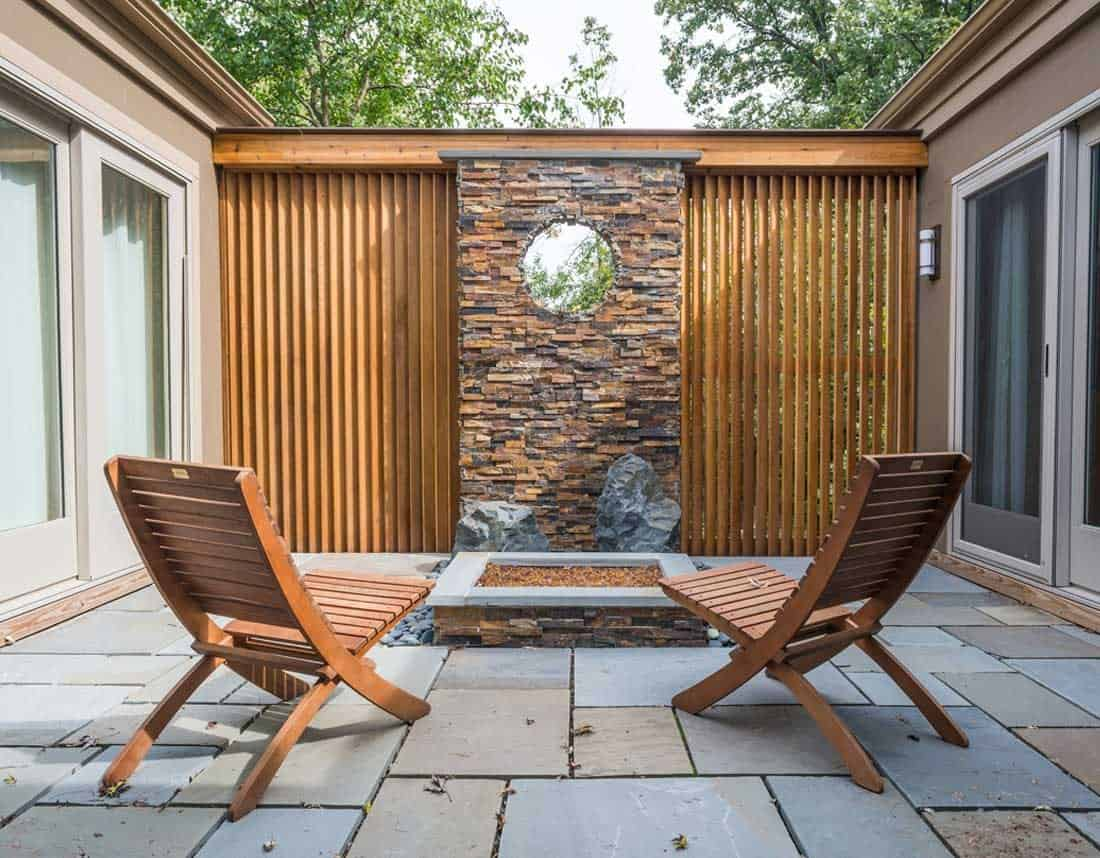 Lotus Gardenscapes -- Contemporary Courtyard and Patio -- Courtyard with Chairs and Wall -- Stone, Wood