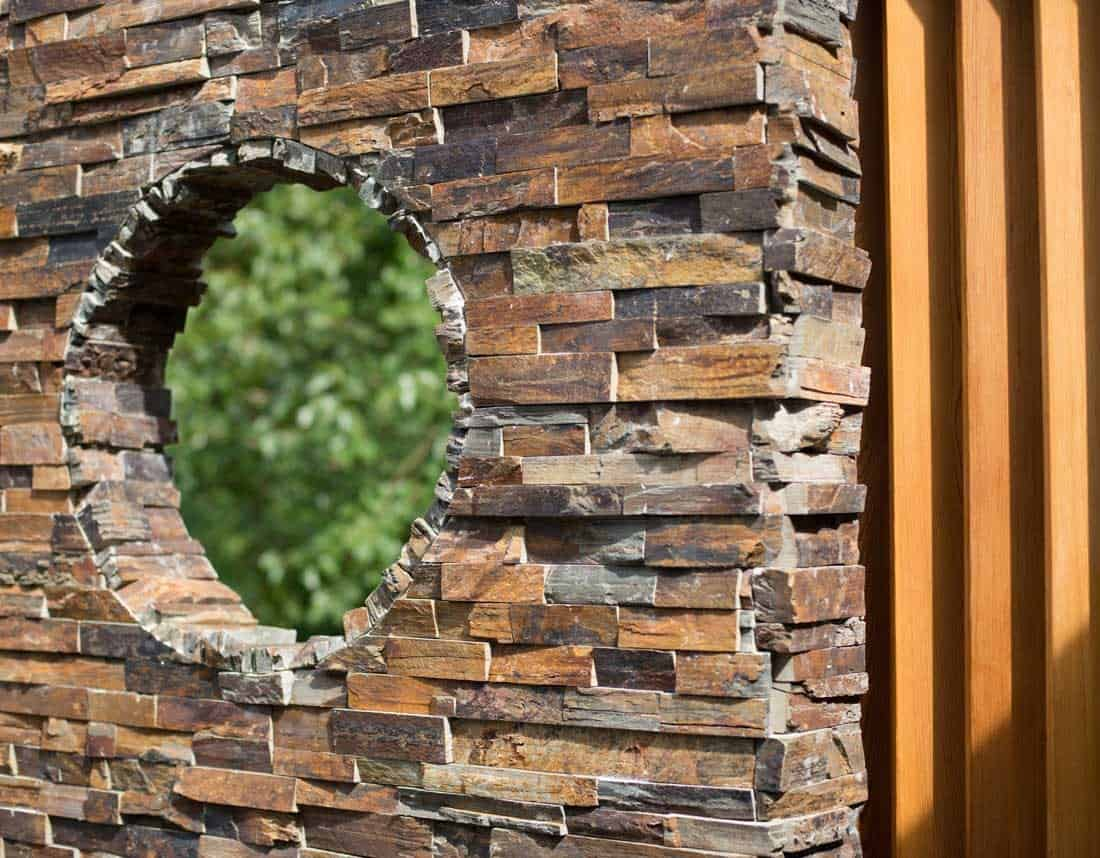 Lotus Gardenscapes -- Contemporary Courtyard and Patio -- Stone Wall and Porthole, Detail -- Stone, Wood